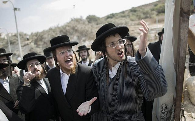 Ultra-Orthodox Jewish men during a demonstration in Beit Shemesh on August 13, 2013. (photo credit: Yonatan Sindel/Flash90)