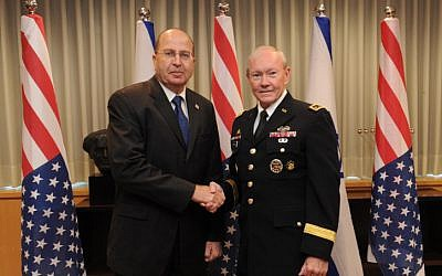 Defense Minister Moshe Ya'alon meets with US Chairman of the Joints Chiefs of Staff Gen. Martin Dempsey at the Defense Ministry in Tel Aviv, on August 14, 2013. (photo credit: Israel Ministry of Defense/Flash90)