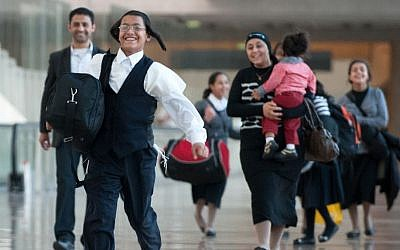 An Orthodox family from Yemen arriving in Israel Wednesday. (photo credit: Moshik Brin/The Jewish Agency/Flash90)