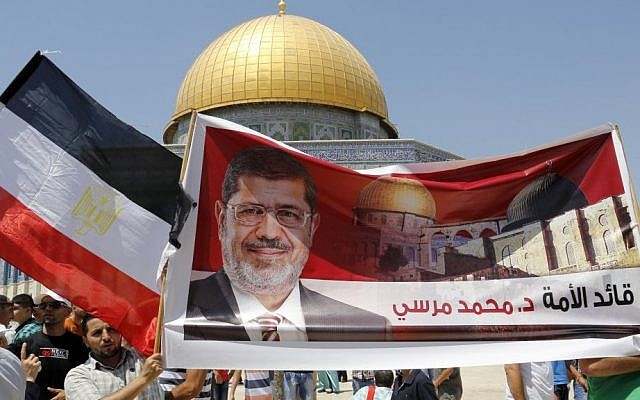 Palestinians carry signs of ousted Egyptian president Mohammed Morsi at a protest Friday on the Temple Mount in Jerusalem (photo credit: Sliman Khader/Flash90)