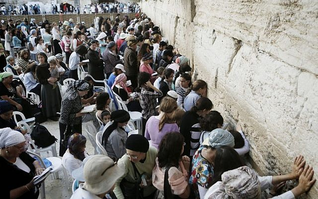 Women seen praying in the women's section of the Western Wall, August 25, 2013. (photo credit: Miriam Alster/Flash90)