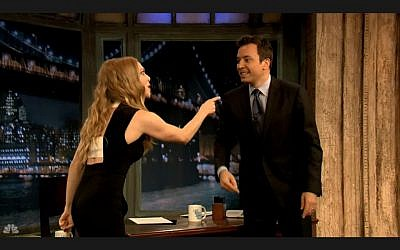 Amanda Seyfried gets rough with Jimmy Fallon (image capture: NBC)