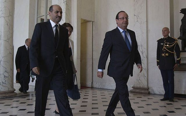 Head of the Syrian National Coalition, Ahmad al-Jarba, left, and France's President Francois Hollande walk in the lobby of the Elysee Palace at the end of August (photo credit: AP/Michel Euler)