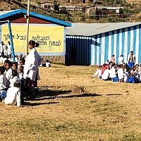 Groups of pupils wait for the teens visiting from Israel to stop by the school (photo credit: Michal Shmulovich/ToI)
