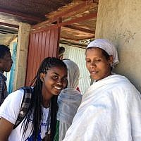 A participant in the Samai trip, which brought Ethiopian-Israeli teens to their native homeland last December, talks to her relative at the Gondar synagogue (photo credit: Michal Shmulovich/ToI)
