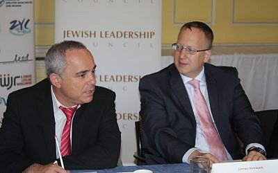 Yuval Steinitz (left), Israel's minister for intelligence and strategic affairs, meets with the Jewish Leadership Council during a visit to England. Courtesy of the Jewish Leadership Council)