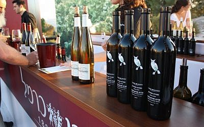 File: Bottles ready to be poured at the tenth annual Israeli Wine Tasting Festival at the Israel Museum (Sarah Sheafer)