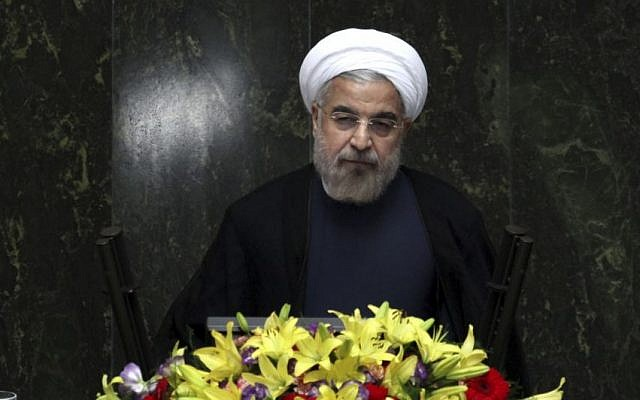 Iranian President Hassan Rouhani speaking at the parliament in Tehran, Iran, on August 15, 2013. (photo credit: AP/Ebrahim Noroozi)
