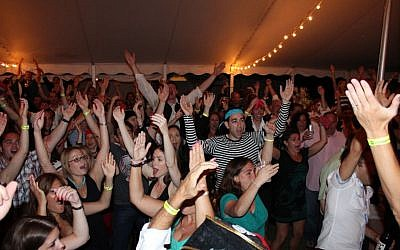 "Jewish singles dance to ""YMCA"" earlier this month at the Club Getaway in Kent, Conn.. (Club Getaway via JTA)"