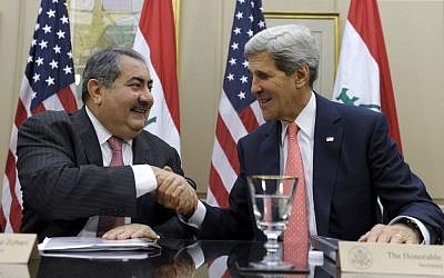 US Secretary of State John Kerry shakes hands with Iraqi Foreign Minister Hoshyar Zebari in Washington on August 15, 2013. (photo credit: Susan Walsh/AP)