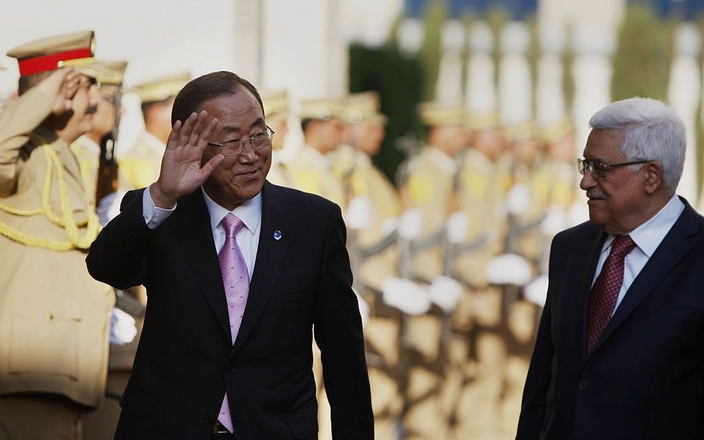 Palestinian President Mahmoud Abbas (right), welcomes UN Secretary-General Ban Ki-moon upon his arrival in Ramallah on August 15 , 2013. (photo credit: AP/Majdi Mohammed)