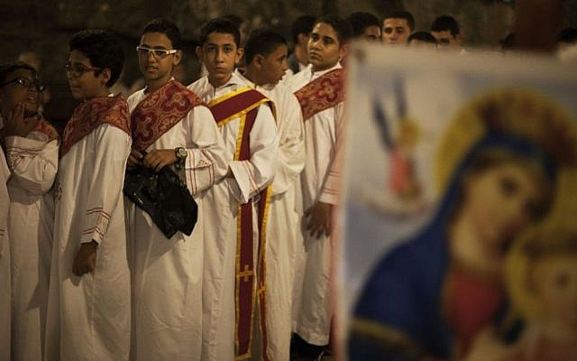 Egyptian youths line up before a procession at Al-Mahraq monastery in Assiut, Upper Egypt, Tuesday, Aug. 6, 2013. (Photo credit: AP/Manu Brabo)