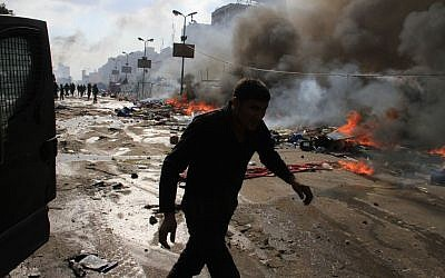 Egyptian security forces clear a sit-in by supporters of ousted Islamist President Mohammed Morsi in the eastern Nasr City district of Cairo, Egypt, Wednesday, Aug. 14, 2013. (Photo credit: AP/Ahmed Gomaa)