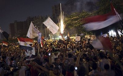 Supporters of Egypt's ousted President Mohammed Morsi wave national flags during a protest near Cairo airport in Cairo, Egypt, Friday, Aug. 2 (photo credit: AP/Khalil Hamra)