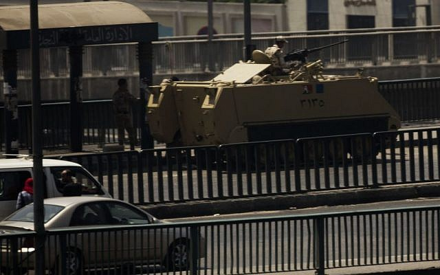 An Egyptian army armored vehicle is seen on a bridge over the Nile river at Zamalek District in Cairo on Saturday. (photo credit: AP/Manu Brabo)