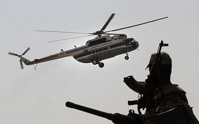 An Egyptian soldier stands guard as a helicopter carrying former Egyptian President Hosni Mubarak, 85, lands at Maadi Military Hospital from Tora Prison in Cairo, Egypt, Thursday, August 22, 2013. Egypt's ousted leader Hosni Mubarak has been released from jail and taken to a military hospital in Cairo. (photo caption: AP Photo/Amr Nabil)
