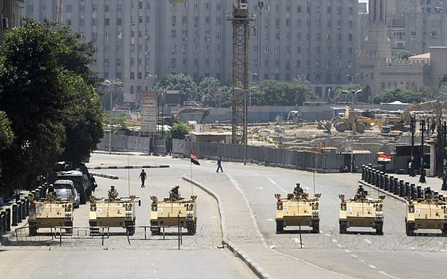 Egyptian army soldiers in armored vehicles block Tahrir Square in Cairo, Egypt, ahead of expected mass rallies, on August 23, 2013 (photo credit: AP/Amr Nabil)