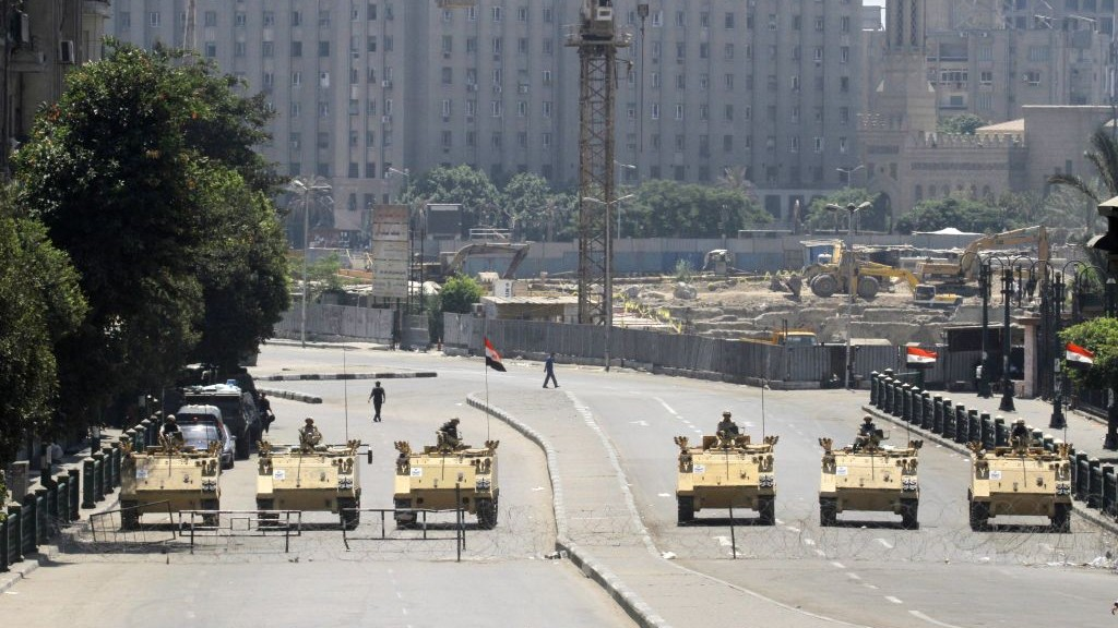 Egyptian army soldiers in armored vehicles block Tahrir Square in Cairo, Egypt, ahead of expected mass rallies on Friday (photo credit: AP/Amr Nabil)