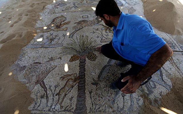 In this Tuesday, August 6, 2013 photo, a man looks at a mosaic at St. Hilarion's monastery in the Jabaliya refugee camp, northern Gaza Strip. (photo credit: AP photo/Hatem Moussa)
