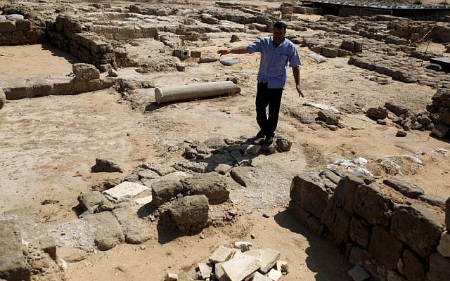 In this Monday, July 22, 2013 photo, a man walks through remains of St. Hilarion's monastery in the Jabaliya refugee camp, northern Gaza Strip. St. Hilarion's monastery, a reminder of the time in late antiquity when Christianity was the dominant faith in what is now the Gaza Strip, is one of many archaeological treasures scattered across this coastal territory. (photo credit: AP Photo/Hatem Moussa)