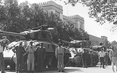 In this August 16, 1953 file photo, Iranian army troops and tanks stand in front of Central Police headquarters after the attempted coup d'etat against Iranian premier Mohammad Mossadeq in Tehran, Iran. (photo credit: AP Photo, File)