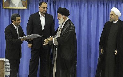 Outgoing president Mahmoud Ahmadinejad, left, delivers the official seal of approval of Supreme Leader Ayatollah Ali Khamenei, center, to give to President Hassan Rouhani, right, in an official endorsement ceremony, in Tehran, Iran, August 3, 2013. (photo credit: AP/Office of the Iranian Supreme Leader)