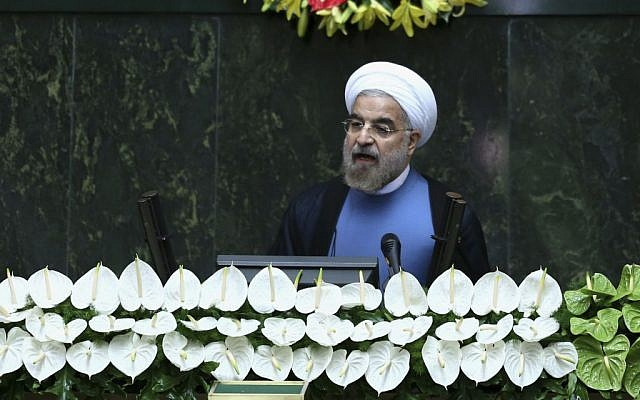 Iran's new President Hasan Rouhani speaks after his swearing-in at the parliament in Tehran, Iran on Sunday, Aug. 4, 2013. (photo credit: Ebrahim Noroozi/AP)