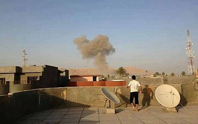 Smoke rises after a bomb attack in Tuz Khormato, 130 miles (210 kilometers) north of Baghdad, Iraq, Saturday, Aug. 10, 2013 (photo credit: AP)