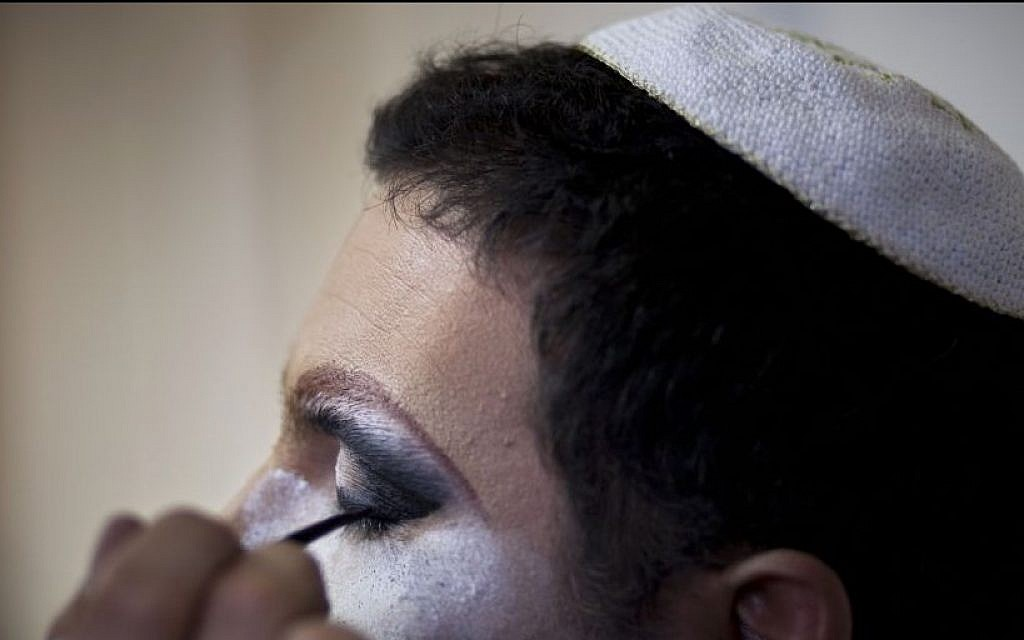 Israeli Orthodox Jew Shahar Hadar has his makeup applied before a show at a drag queen school in downtown Tel Aviv, Israel, Tuesday, June 18, 2013. (photo credit: AP/Oded Balilty)