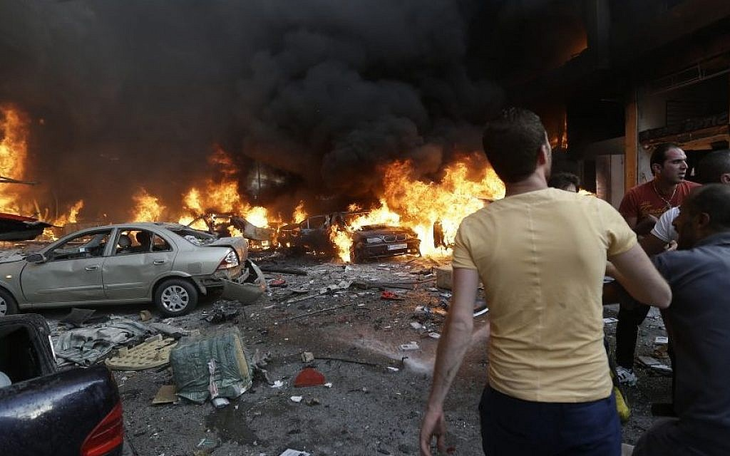 Lebanese citizens gather at the site of a car bomb explosion in southern Beirut, Lebanon, on Thursday, August 15, 2013. (photo credit: AP/Hussein Malla)