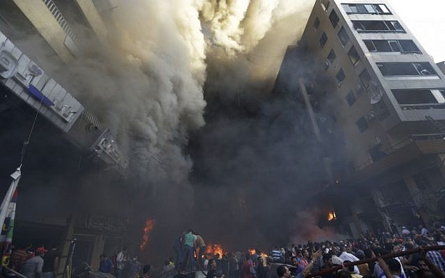 Smoke pours from buildings after a bomb attack in Beirut Thursday. (photo credit: AP/Hussein Malla)