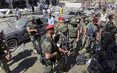 Lebanese Army soldiers at the site of a car bomb explosion outside the Salam Mosque, in the northern city of Tripoli, Lebanon, on August 24, 2013 (photo credit: AP/Bilal Hussein)