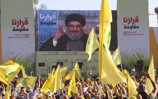 Hezbollah chief Hassan Nasrallah addressing supporters via satellite link during a rally in the southern Lebanese border village of Aita in August 2013. (photo credit: AP/Mohammed Zaatari)