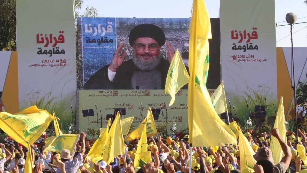 Illustrative photo of Hezbollah chief Hassan Nasrallah addressing supporters via satellite link during a rally in the southern Lebanese border village of Aita in August 2013. (photo credit: AP/Mohammed Zaatari)