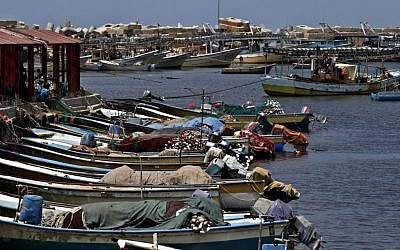 Palestinian boats wait to sail as they refuel at the fishermen sea port in Gaza City on Wednesday, July 31 (photo credit: AP/Adel Hana)