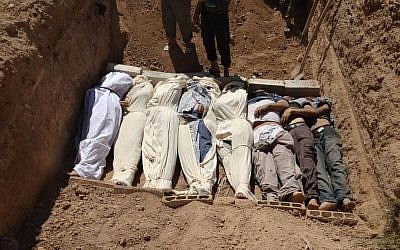 Bodies being buried after the August 21 chemical attack near Damascus (photo credit: AP/Shaam News Network)