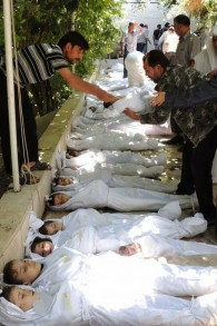 Syrian citizens trying to identify dead bodies, after an alleged poisonous gas attack fired by regime forces, according to activists in Syria, Wednesday, August 21, 2013. (photo credit: AP/Local Committee of Arbeen)