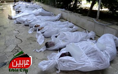 This citizen journalism image provided by the Local Committee of Arbeen which has been authenticated based on its contents and other AP reporting, shows dead bodies of Syrian citizens in Arbeen, near Damascus, on Wednesday. (photo credit: AP/Local Committee of Arbeen)