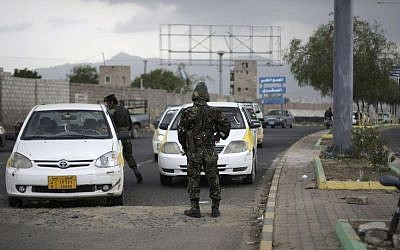 Police stop cars at a checkpoint near the US embassy in Sanaa, Yemen, in August 2013 (photo credit: AP/Hani Mohammed)