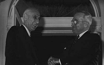 US President Harry S. Truman, right, greets Iranian Prime Minister Mohammed Mossadegh as the latter arrives in Washington, DC, in 1951 (photo credit: Harry S. Truman Library and Museum/Wikimedia Commons)