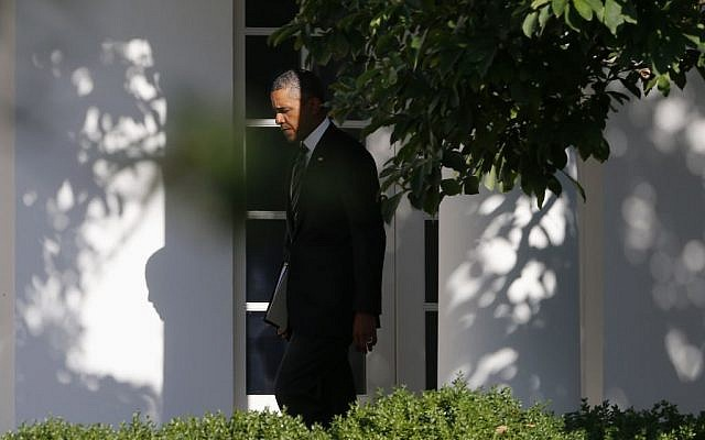 President Barack Obama walks along the West Wing colonnade of the White House in Washington, August 22, 2013, (photo credit: AP/Charles Dharapak)