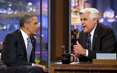 "US President Barack Obama, left, talks with Jay Leno during a commercial break at a taping of ""The Tonight Show with Jay Leno"" in Los Angeles, in August 2013. (photo credit: AP/Jacquelyn Martin)"
