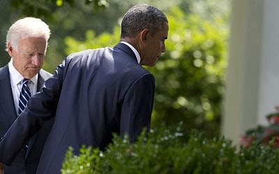 Vice President Joe Biden, left, follows President Barack Obama as he leaves the Rose Garden after making a statement about the crisis in Syria at the White House in Washington Saturday, Aug. 31, 2013 (photo credit: AP Photo/Evan Vucci)