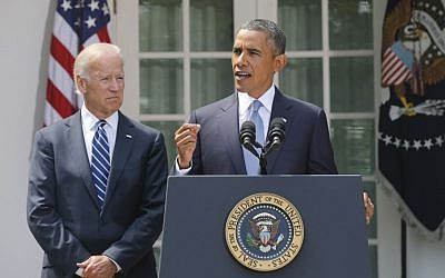 US President Barack Obama stands with Vice President Joe Biden as he makes a statement about Syria in the Rose Garden at the White House in Washington, Saturday. (AP Photo/Charles Dharapak)