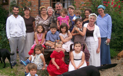 "Philip Sharp (center), England's ""Rampant Rabbi,"" has ""married"" six women and fathered 18 children, not all of whom are pictured here. (Courtesy of Judith Sharp)"