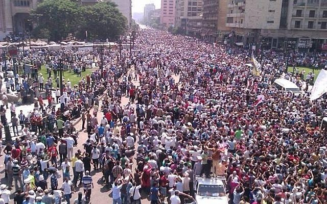 Thousands gathering in Cairo's Ramses Square on Friday (photo credit: GilandMahesa via Twitter)