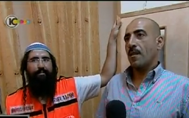 Haim Attias, a medic and a settler, and Haitham Azloni, an Arab resident of East Jerusalem whose life he saved, meet in Jerusalem. (photo credit: screenshot Channel 10 News)