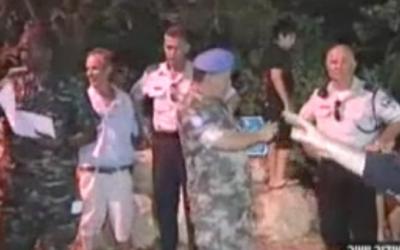 UNIFIL personnel inspect rocket damage at Kibbutz Gesher Haziv on Thursday night (photo credit; Channel 2 screenshot)