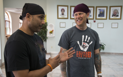 Former white supremacist Arno Michaelis (right) formed an alliance with Pardeep Kaleka after last year's deadly shooting at the Sikh Temple of Wisconsin. (Morry Gash/AP)