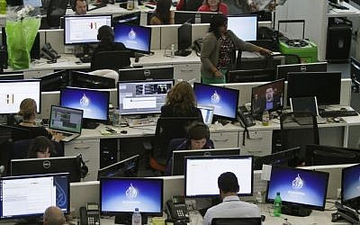 Al-Jazeera America newsroom in New York (photo credit: AP/Bebeto Matthews/File)